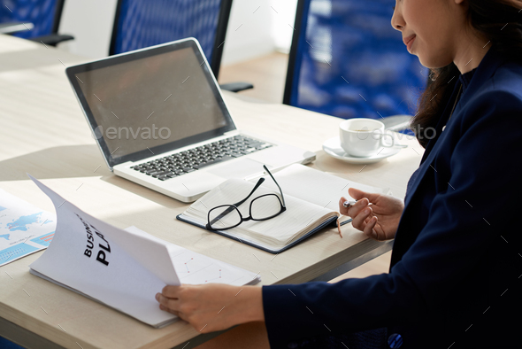 Analyzing Statistics in Boardroom - Stock Photo - Images