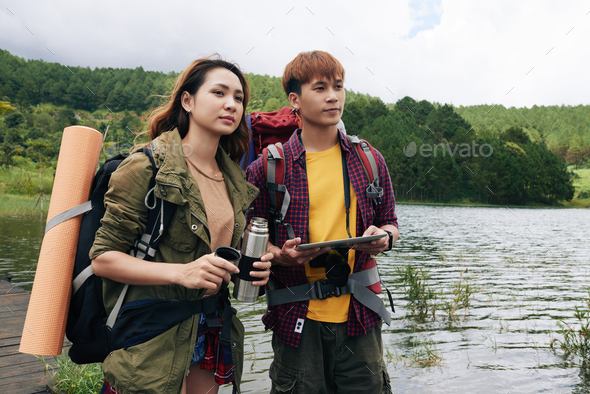 Asian Couple Enjoying Hiking Trip - Stock Photo - Images