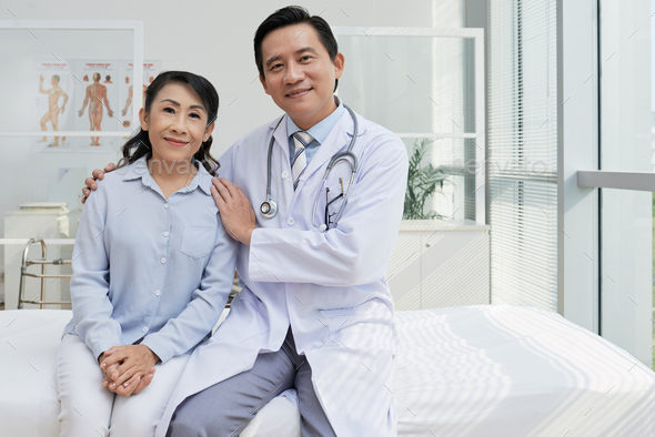 Portrait of Friendly Physician and His Patient - Stock Photo - Images