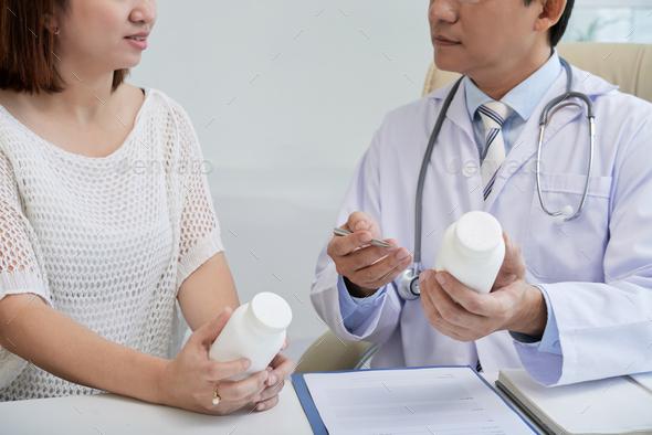 Doctor Prescribing Pills - Stock Photo - Images