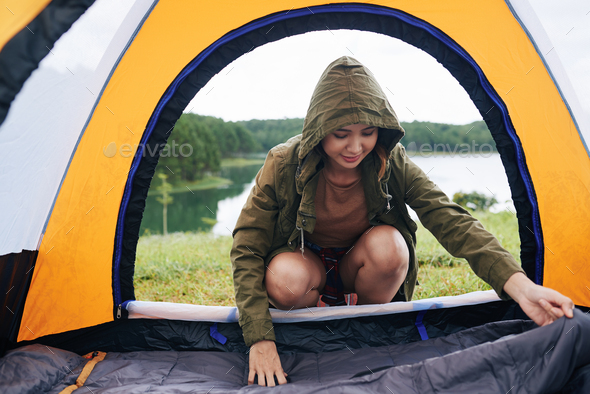 Attractive Hiker Setting up Tent - Stock Photo - Images