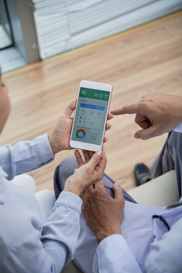 Senior Patient Using Health Monitoring App - Stock Photo - Images