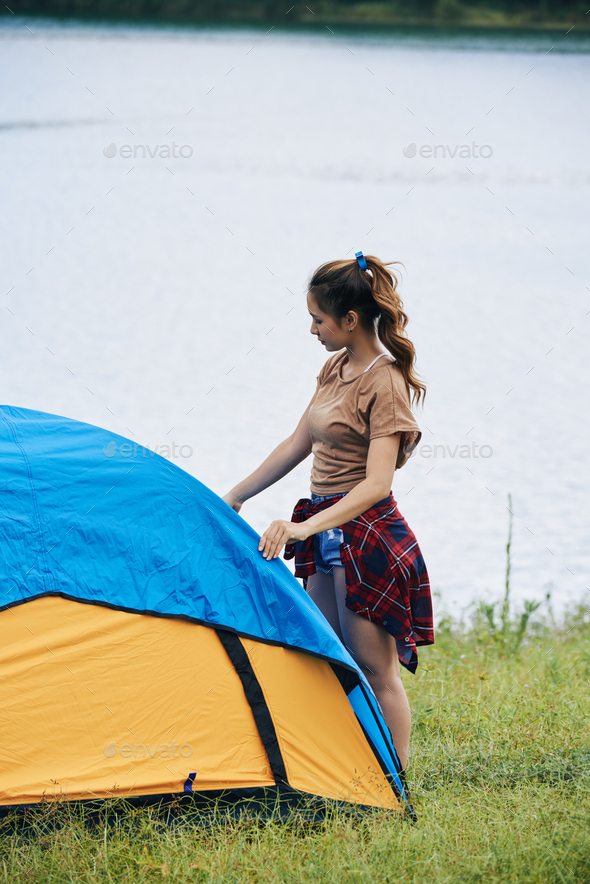 Pretty Woman Setting up Tent - Stock Photo - Images