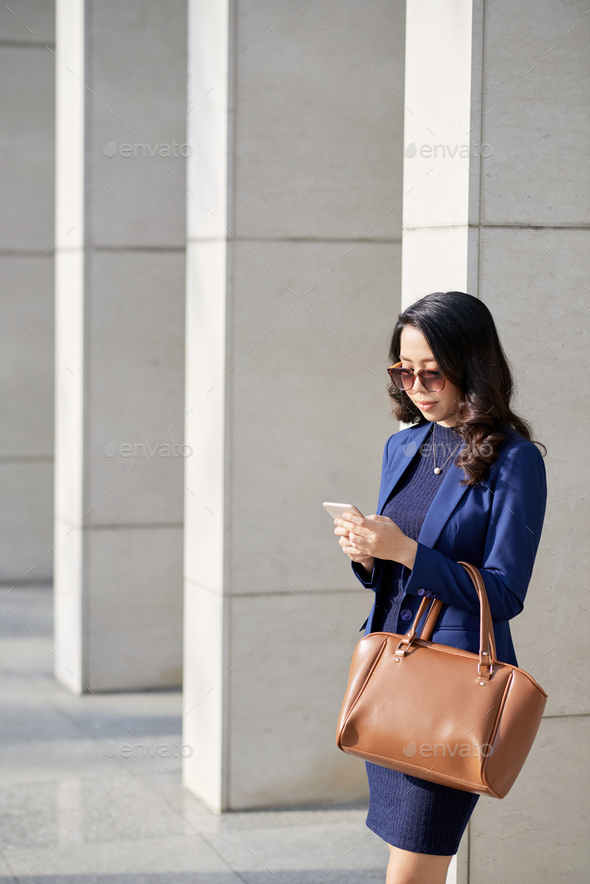 Asian Designer Using Smartphone - Stock Photo - Images