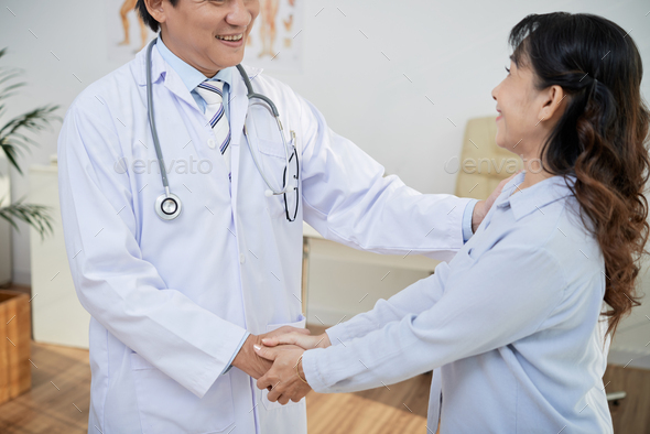 Receiving Good News from Doctor - Stock Photo - Images