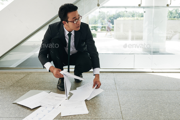 Collecting fallen documents - Stock Photo - Images