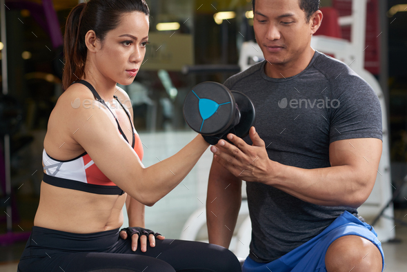 Exercising with trainer - Stock Photo - Images