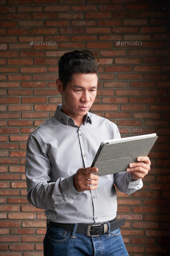 Confident Entrepreneur Using Digital Tablet - Stock Photo - Images