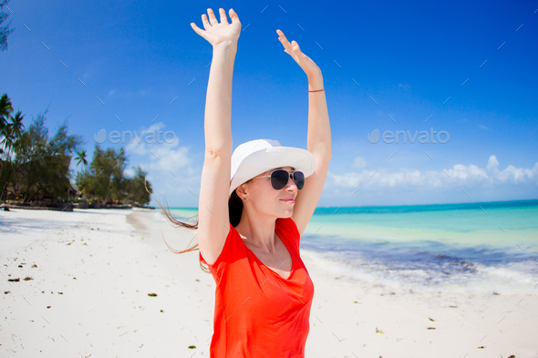 Happy woman in hat on tropical beach enjoy her vacation - Stock Photo - Images