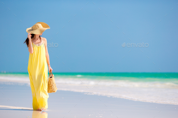 Young woman in hat during tropical beach vacation - Stock Photo - Images