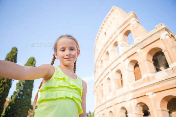 Little girl making selfie background Coliseum, Rome, Italy. Kid portrait at famous places in Europe - Stock Photo - Images