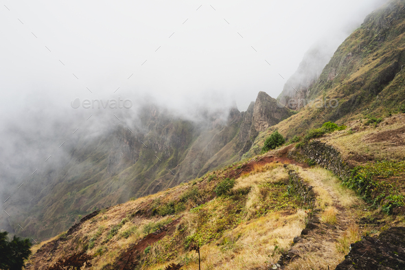 Santo Antao, Cape Verde. Mountain ridge covered in fog on the hike to Xoxo in the Ribeira da Torre - Stock Photo - Images