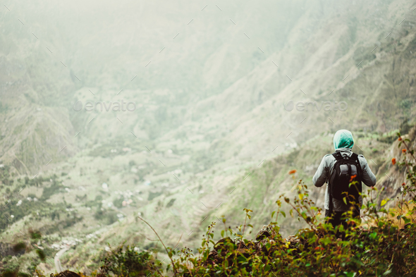 Man tourist with backpack enjoying valley rural landscape on hike path at Santo Antao Island, Cape - Stock Photo - Images