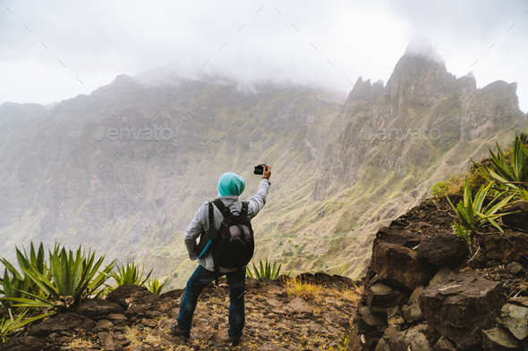 Santo Antao Island, Cape Verde. Travel hiker making picture of arid mountain top in surreal Xo Xo - Stock Photo - Images