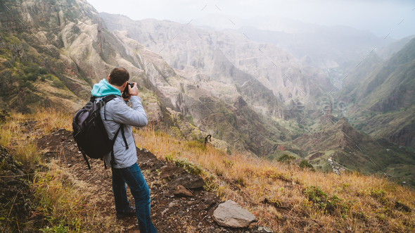 Santo Antao Island, Cape Verde. Travel hiker photographing Xo Xo valley and terrain mountain - Stock Photo - Images