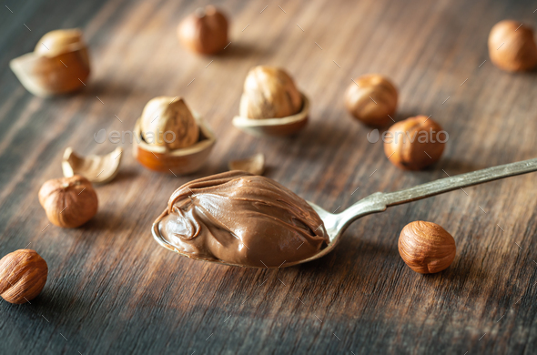 Spoon of chocolate paste with hazelnuts - Stock Photo - Images