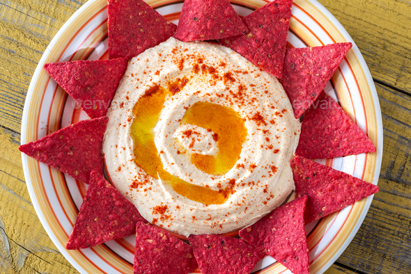 Hummus with tortilla chips - Stock Photo - Images