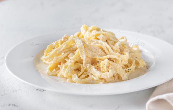 Portion of Shrimp Alfredo Pasta - Stock Photo - Images