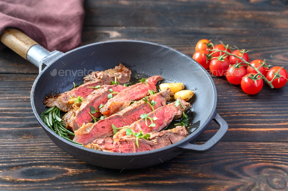 Beef steak in the frying pan - Stock Photo - Images
