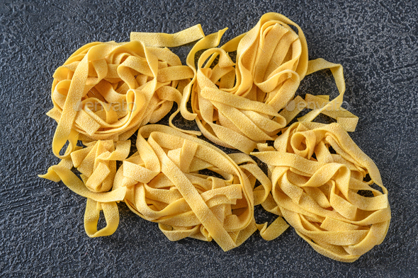 Raw pappardelle pasta - Stock Photo - Images