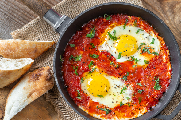 Shakshouka served in a frying pan - Stock Photo - Images