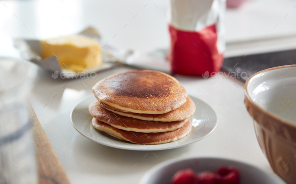 Stack Of Freshly Made Pancakes Or Crepes On Table For Pancake Day - Stock Photo - Images