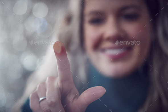 View From Behind Touch Screen As Woman Uses Digital Tablet Online At Home - Stock Photo - Images