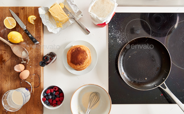Overhead Shot Of Freshly Made Pancakes Or Crepes For Pancake Day With Maple Syrup And Berries - Stock Photo - Images