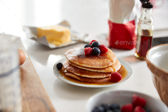 Stack Of Freshly Made Pancakes Or Crepes With Maple Syrup And Berries On Table For Pancake Day - Stock Photo - Images