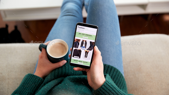Close Up Of Woman Shopping For Clothes Online Using Mobile Phone App - Stock Photo - Images