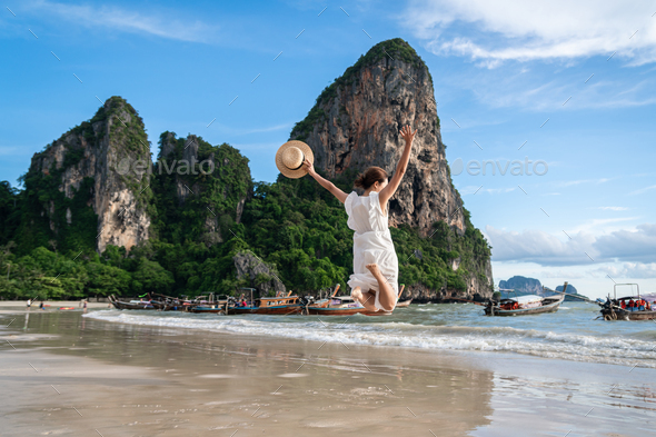 Young woman traveler enjoying a summer vacation at tropical sand beach in Krabi, Thailand - Stock Photo - Images