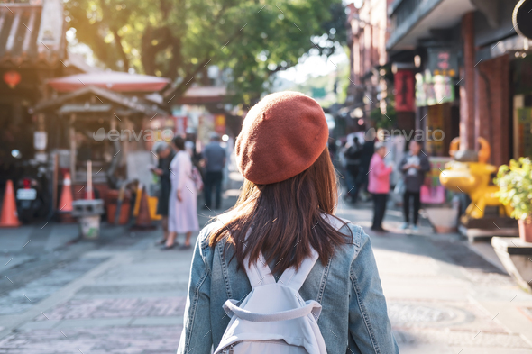 Young woman traveler walking in the shopping street, Travel lifestyle concept - Stock Photo - Images