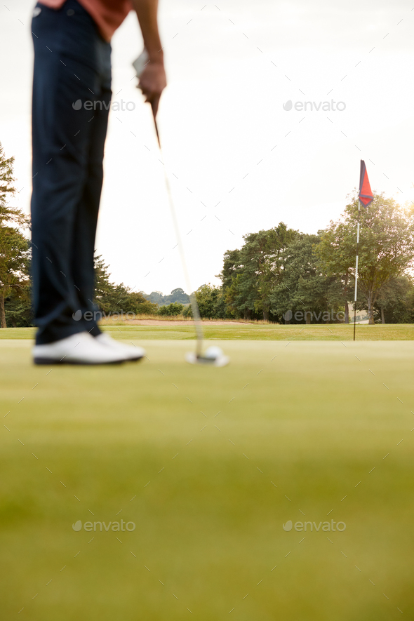 Close Up Of Female Golfer Putting Ball On Green - Stock Photo - Images
