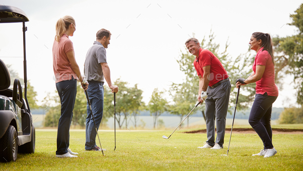 Golf Professional Demonstrating Shot On Fairway To Group Of Golfers During Lesson - Stock Photo - Images