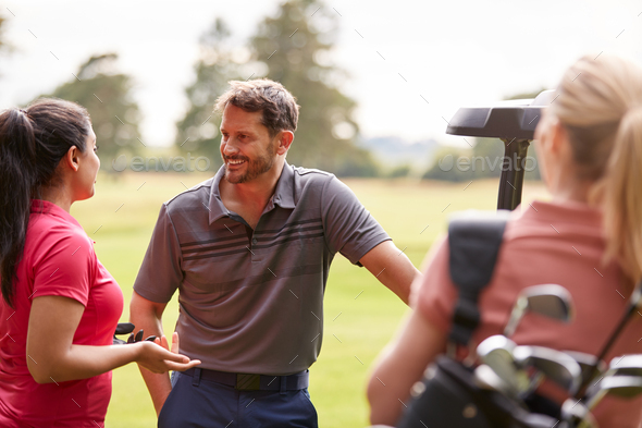 Group Of Male And Female Golfers Standing By Golf Buggy On Course - Stock Photo - Images