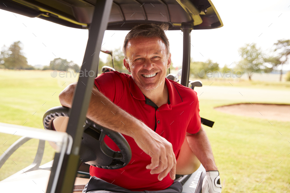 Portrait Of Mature Man Playing Golf Driving Buggy Along Course To Green On Red Letter Day - Stock Photo - Images