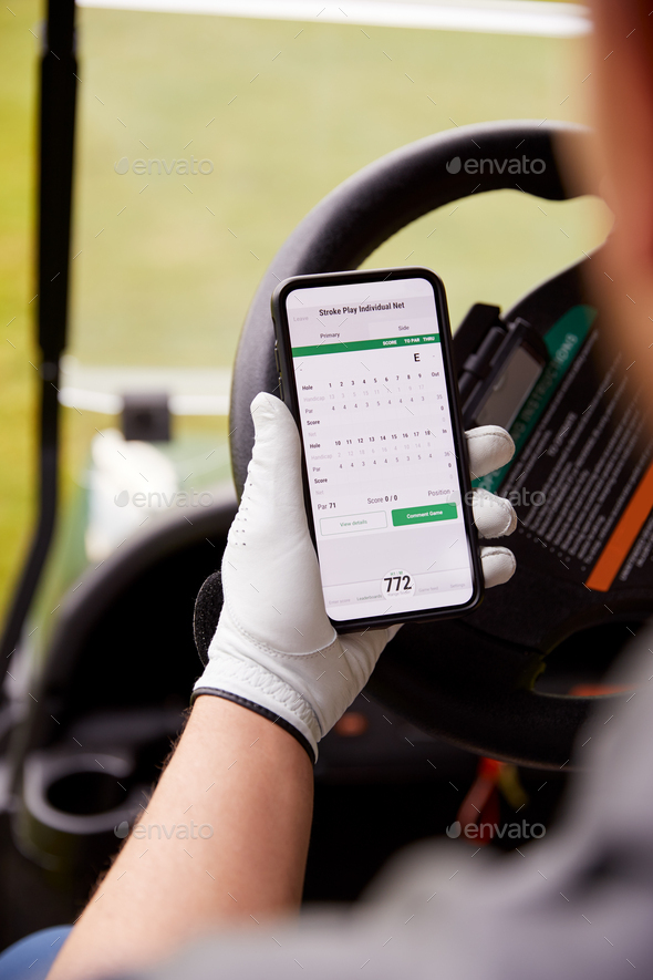 Close Up Of Male Golfer In Buggy Checking Score On Mobile Phone App - Stock Photo - Images