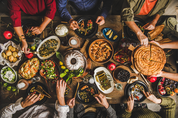 Turkish family celebrating at table with traditional foods and raki - Stock Photo - Images