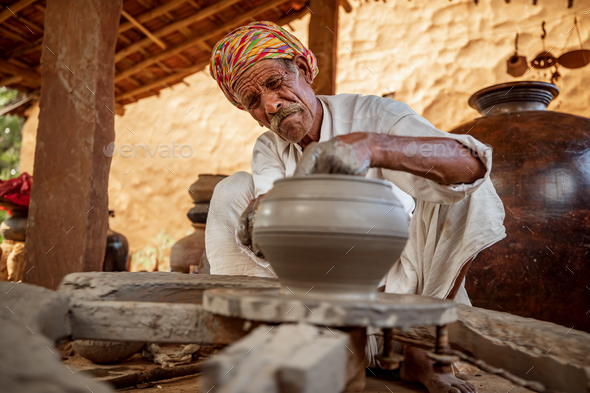 Potter at work makes ceramic dishes. India, Rajasthan. - Stock Photo - Images