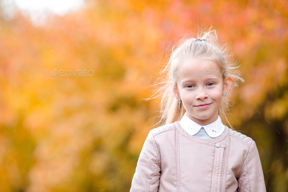 Autumn time. Little kid in fall - Stock Photo - Images