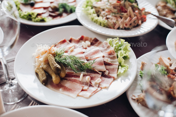 Banquet table served with various cold snacks and salads - Stock Photo - Images