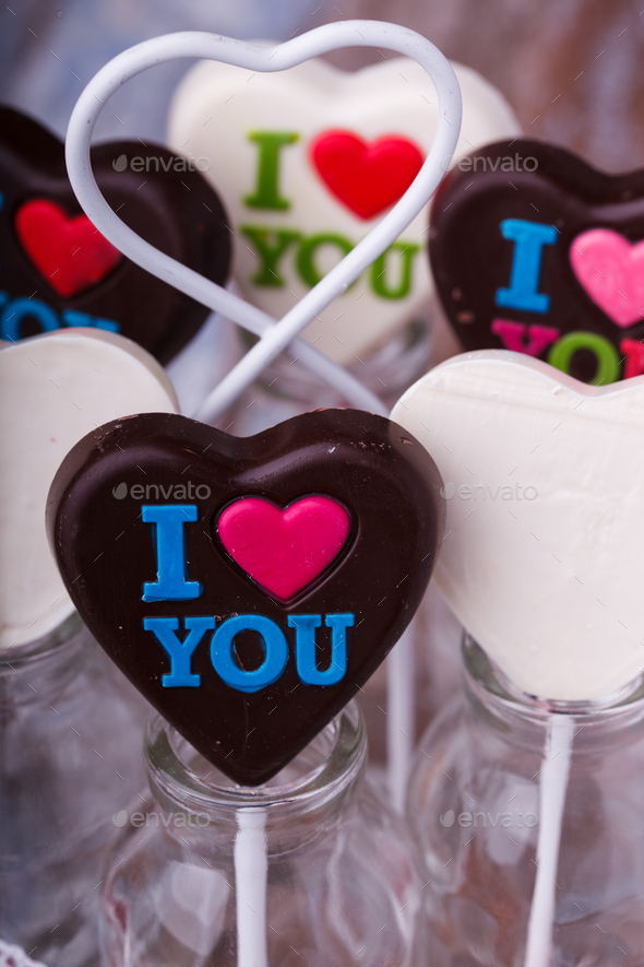 Chocolates on sticks in the shape of a heart - Stock Photo - Images