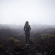 Young woman contemplating the fog on her way to Teide top in Tenerife, Spain - PhotoDune Item for Sale