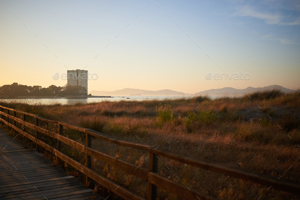 View of the Toralla island in Vigo, from a passarel over the dunes in Vao beach - Stock Photo - Images