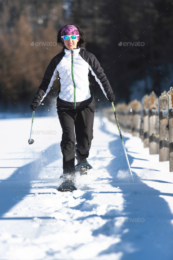 Snowshoes. Woman during an excursion - Stock Photo - Images
