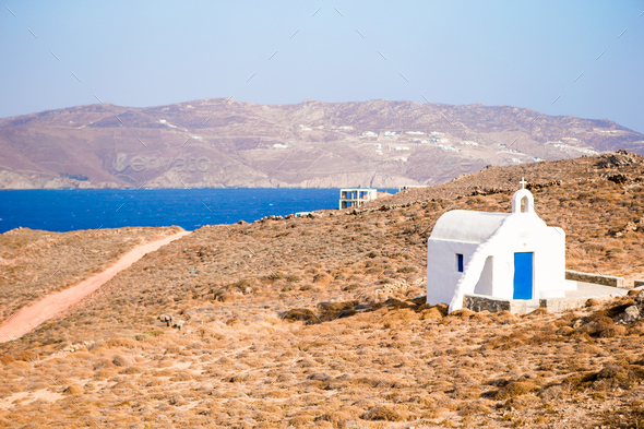 Traditional white church with sea view in Mykonos island,Greece - Stock Photo - Images