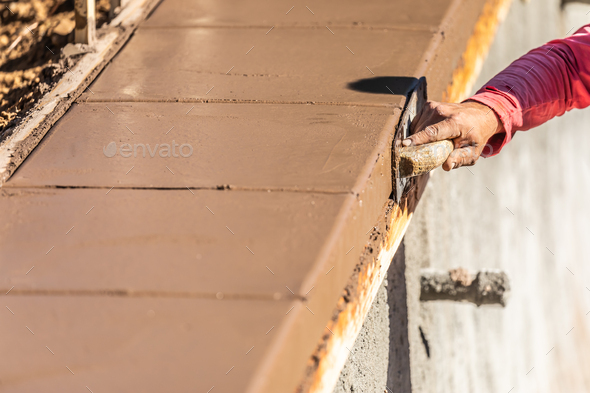 Construction Worker Using Stainless Steel Edger On Wet Cement Forming Coping Around New Pool - Stock Photo - Images