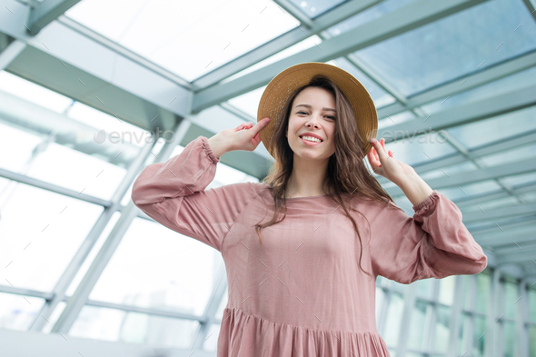 Portrait of young woman an airport lounge waiting for boarding in international airport - Stock Photo - Images
