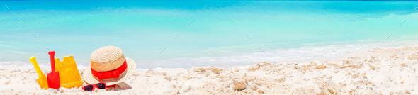 Kid's beach toys on white sandy beach. Panorama of white beach - Stock Photo - Images