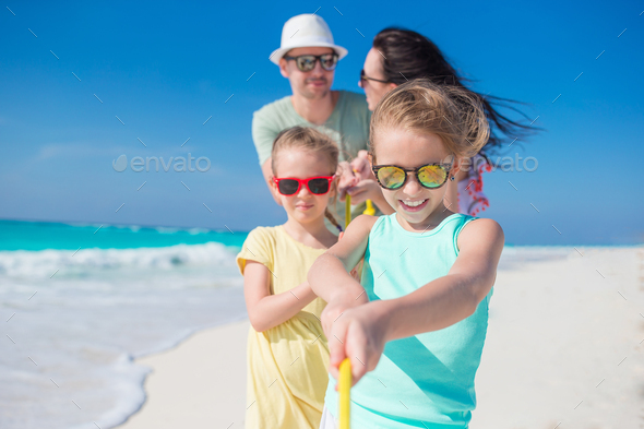 Parents and kids on beach vacation. Closeup of family - Stock Photo - Images